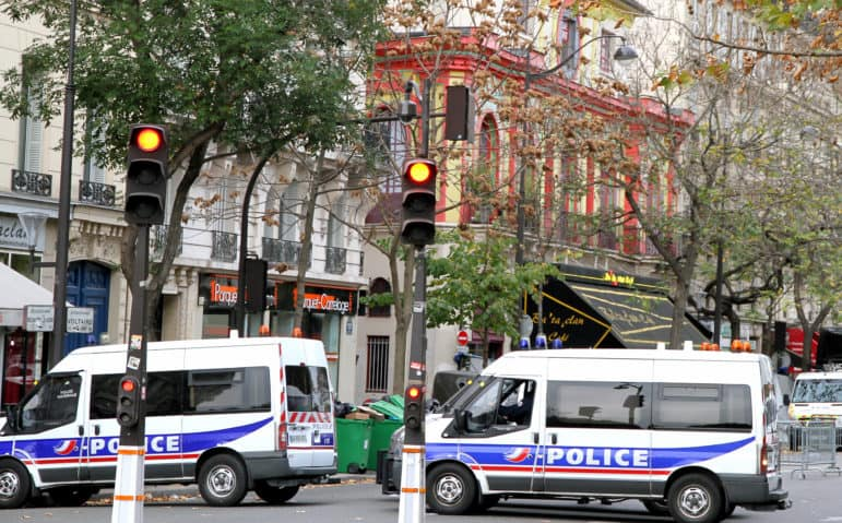French police gathering evidence at the Bataclan Theatre the day after the recent attacks in Paris. (photo cc info)