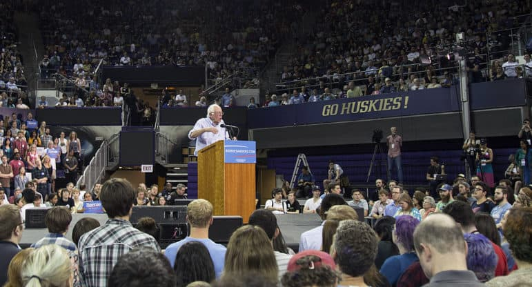 Bernie Sanders, who identifies as a democratic socialist, has been met by large crowds across America, including this crowd in Seattle in August. (photo cc info)