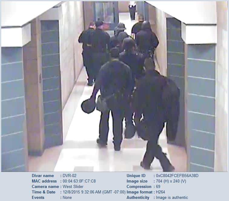 A screen shot from a security camera at the Doña Ana County Detention Center showing officers from the Sheriff's Department taking control of the facility on Dec. 8.