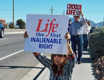 A scene from a recent demonstration against abortion in Las Cruces. The author pledges that his organization will redouble our efforts to advance a climate of nonjudgmental understanding and peaceful non-violence.