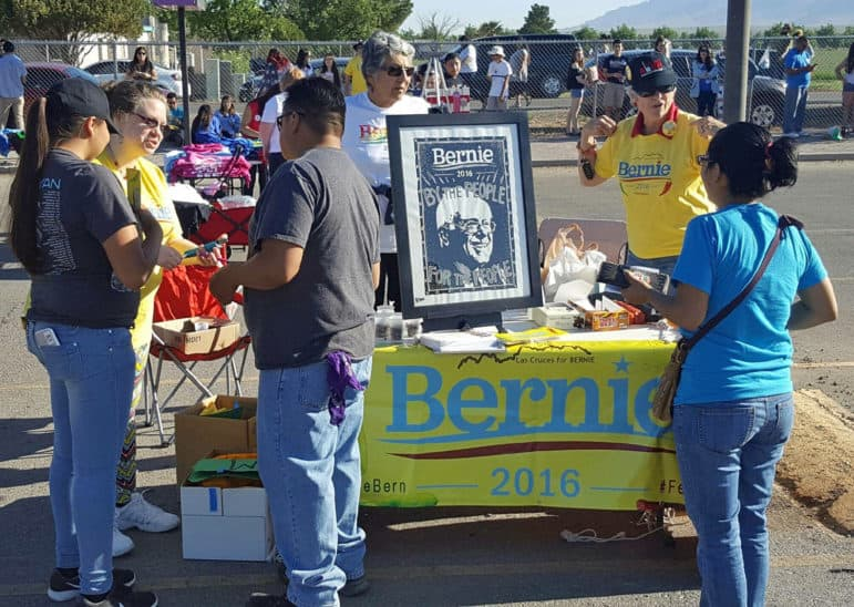 People involved with the group Las Cruces for BERNIE set up a table outside Sanders' rally in Vado on Saturday.