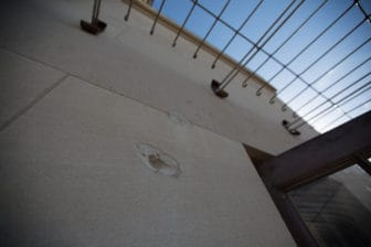 Fifty years later, a bullet hole remains in the wall of the UT Tower's observation deck.